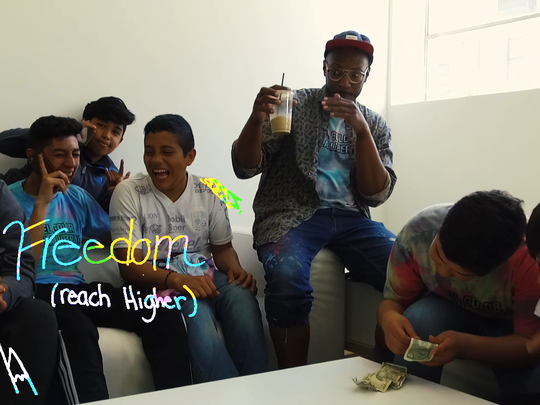 "Mikal Floyd-Pruitt and students from Alexander Mitchell school hang out while they're filming the video for their song ""El Color de la Libertad."""