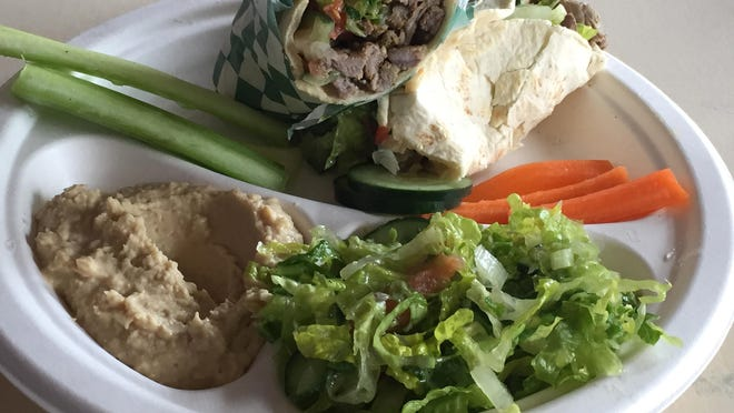 A beef shawarma combination plate at the new Hummus Fresh in northwest Reno includes hummus and a salad. The original Hummus Fresh opened on California Avenue in 2015.
