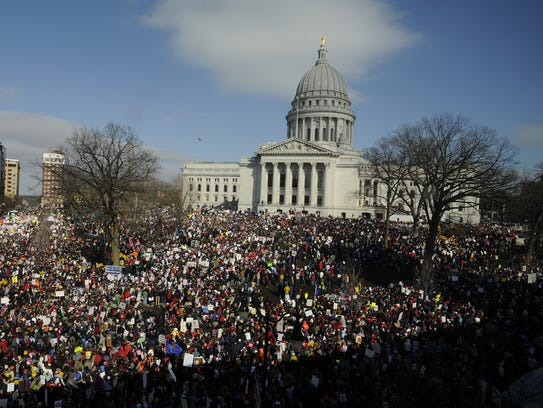 Thousands of state employees and their supporters rallied