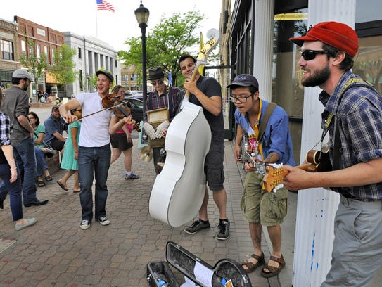 The Zombie Pit String Band entertains people along