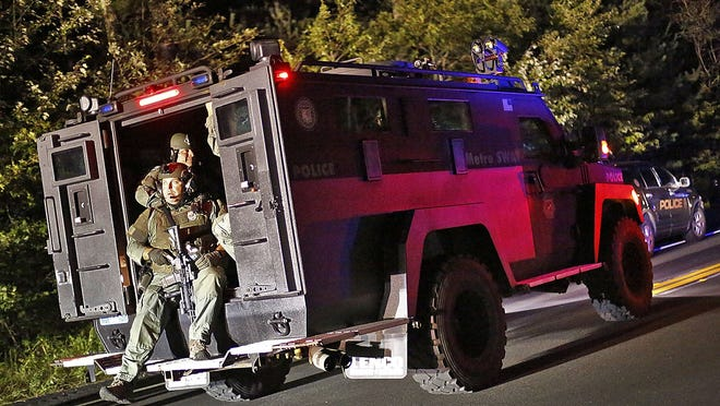 Heavily-armed MetroLec swat officers in Marshfield on Monday, Sept. 24, 2018. Greg Derr/ The Patriot Ledger