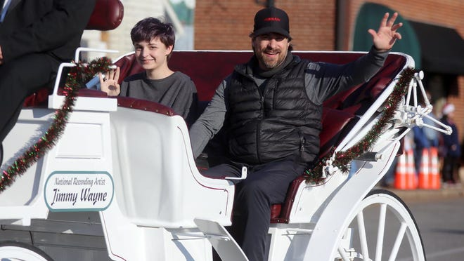 Jimmy Wayne waves to the crowd while riding in Kings Mountain's annual Christmas parade in 2019. Wayne was recently inducted into the Cleveland County Music Hall of Fame.