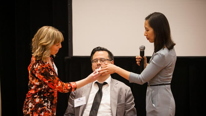 Baltimore City Health Commissioner Dr. Leana Wen, right, shows Tribune reporter Andrea Fisher how to use Narcan, a nasal spray form of the opioid overdose reversal drug naloxone, during a presentation April 12 in Baltimore.
