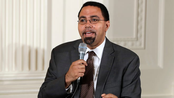 In this July 19, 2016, file photo, Education Secretary John B. King, Jr., speaks on a panel with first lady Michelle Obama to college-bound students participating in the Reach Higher initiative's third annual Beating the Odds event in the East Room of the White House in Washington.