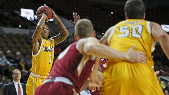UWM's Jeremiah Bell goes up for two of his 10 points Sunday against Elon in the Black & Gold Shootout.