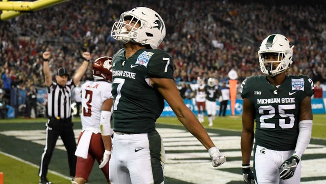 Michigan State wide receiver Cody White (7) celebrates a touchdown catch against Washington State during the first half of the Holiday Bowl NCAA college football game Thursday, Dec. 28, 2017, in San Diego.