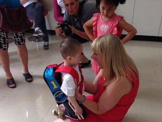 Megan Christofferson, 36, hugs son Bo, the newest addition to her family. The Christoffersons met Bo, who has Down syndrome, at an orphanage in China when they traveled there to adopt daughters Elle and Mae. Their son Carsten also has Down syndrome