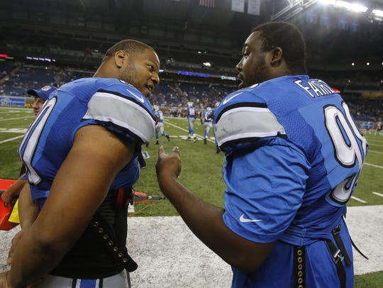 Detroit Lions defensive linemen Ndamukong Suh, left,