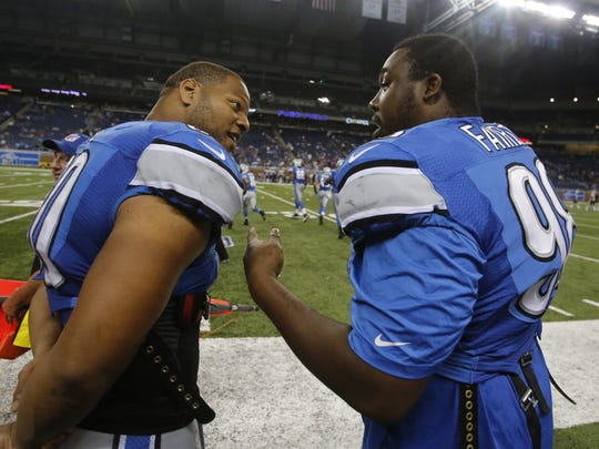 Detroit Lions defensive linemen Ndamukong Suh, left, and Nick Fairley, talk on the sideline in the final minutes of their 40-9 win over the New England Patriots in an exhibition game in Detroit on Aug. 22, 2013.