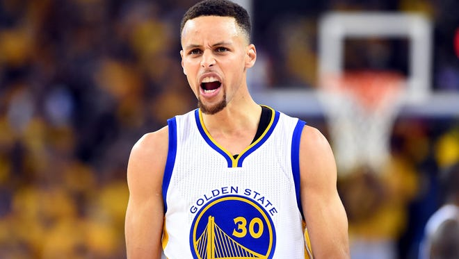 Golden State Warriors guard Stephen Curry (30) reacts during the first quarter against the Cleveland Cavaliers in Game 5.