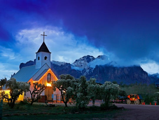 A church at Superstition Mountain Museum glows under