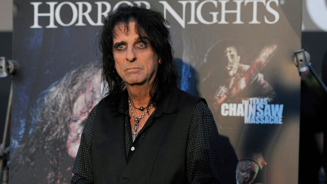Alice Cooper poses at the Eyegore Awards at Universal Studios Hollywood in Los Angeles on Sept. 21, 2012. Cooper said many contemporary male artists lack the glamour and over-the-top theatricality of being a rock star.
