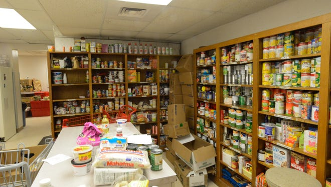 The ABCCM donation center is filled with canned goods and other needed items in this file photo. The nonprofit lists its most urgent needs on its website.