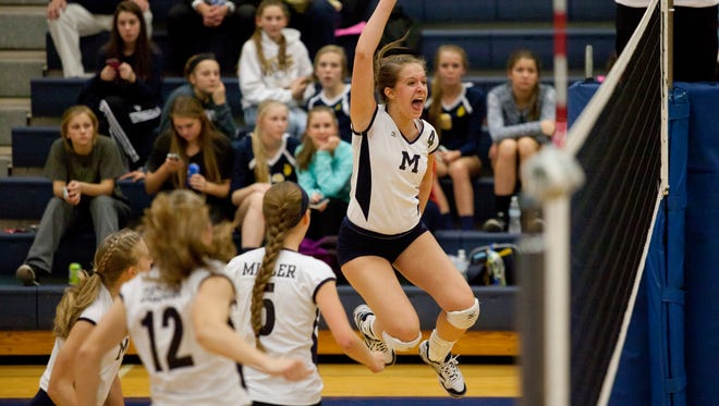 Marysville senior Bailey Bowns celebrates scoring a point during a regional semifinal volleyball game Tuesday, November 10, 2015 at Imlay City High School.
