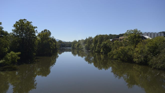 A view of the French Broad River from Craven Street bridge in the River Arts District.