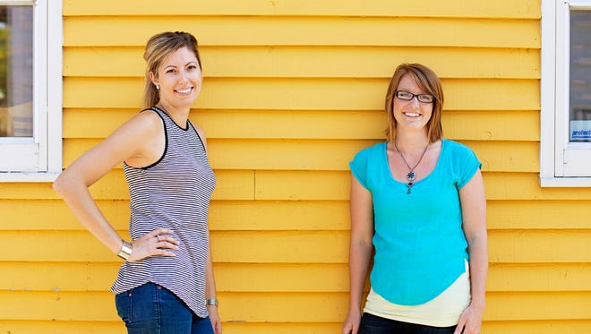 Sarah Feldmann (left) and Lyssa Schmidt are co-founders of Clever Dog Creative, now located in Appleton.