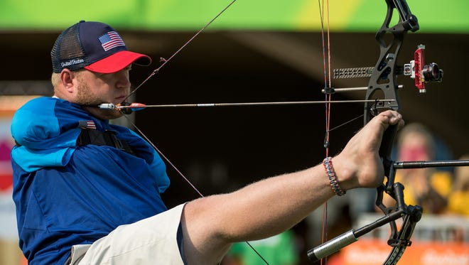 Matt Stutzman USA competes in the 1/8 Elimination Round of the Men's Individual Compound Open Archery contest against Andrey Muniz de Castro BRA at Sambódromo. Stutzman was born without arms and had to devise a way to compete. He uses his left foot to place the arrow while holding the bow with his right foot. Then he pulls the string of the bow, with the arrow, back with a contraption attached to his right shoulder. Finally, he moves his jaw to trigger the contraption and release the arrow. The Paralympic Games, Rio de Janeiro, Brazil, Wednesday 14th September 2016. Photo: Thomas Lovelock for OIS/IOC.  Handout image supplied by OIS/IOC