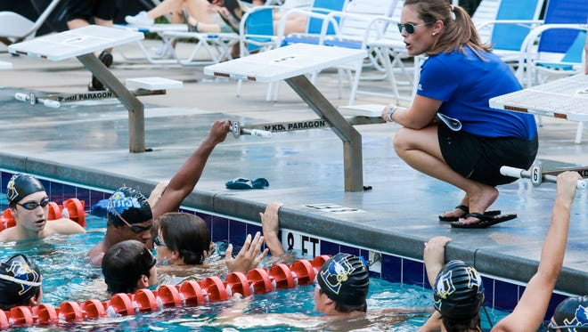 Eastside swim coach Tiffany Watson instructs members of the boys team during a meet earlier this season at Stone Lake Pool. The Eagles are among the chief contenders for the Class AAAA title.