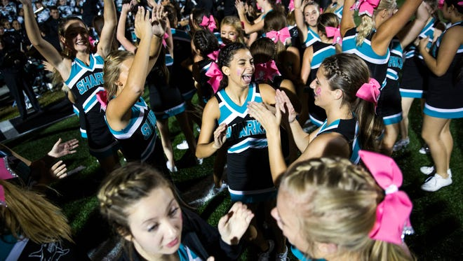 Gulf Coast High School cheerleaders celebrate their win against South Fort Myers on Friday, October 28, 2016 at Gulf Coast High School in Golden Gate. Gulf Coast High School won the game, sending them to the playoffs.