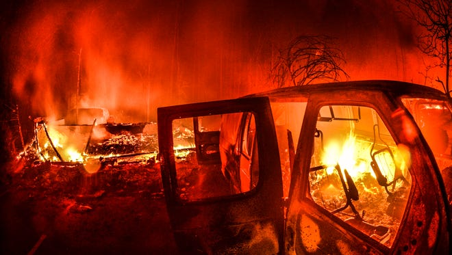 DO NOT USE THIS PHOTO>>>> MARCIA    Cars burn in front of the main entrance of the Westgate Smoky Mountain Resort in Gatlinburg on Tuesday, Nov. 29, 2016, during the middle of the wildfire that ravaged Sevier County.