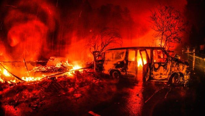 DO NOT USE Cars burn in front of the main entrance of the Westgate Smoky Mountain Resort in Gatlinburg on Tuesday, Nov. 29, 2016, during the middle of the wildfire that ravaged Sevier County.