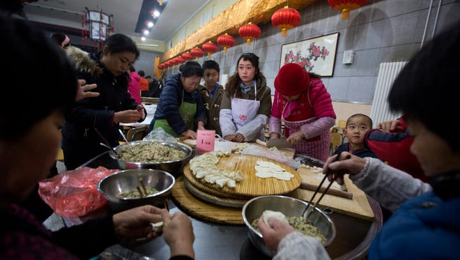 Villagers gather to make dumplings ahead of the lunar Chinese new year at a village on the outskirts of Beijing, China, Thursday, Jan. 26, 2017.