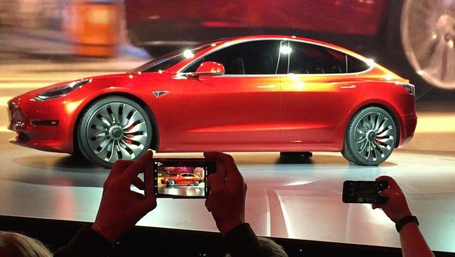 Tesla Motors unveils the new lower-priced Model 3 sedan.