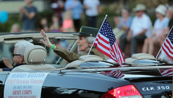 WWII veteran Anne Weston waves to the crowd  during the Palm Springs Veterans Day Parade on Saturday, November 11, 2017 in Palm Springs.