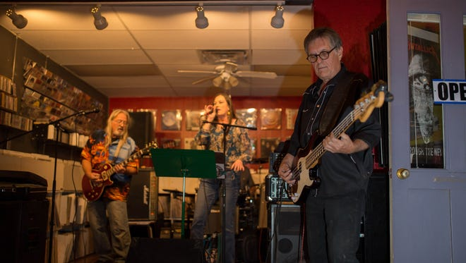 Leslie Skaggs, right, of The Beaux Peep Show performs with his band mates at Eyeconik Records & Apparel on Dec. 1 for the venue's live music event.