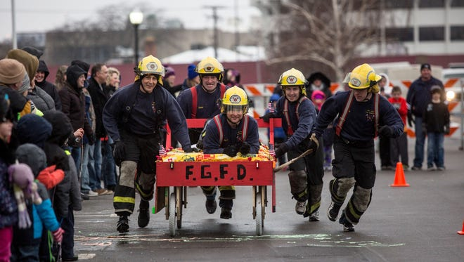 Team Fort Gratiot Fire Department competes during the Chilly Fest bed races Saturday in downtown Port Huron. Team Fort Gratiot Fire Department competes during the Chilly Fest bed races Saturday, Jan. 28, 2017 in downtown Port Huron.
