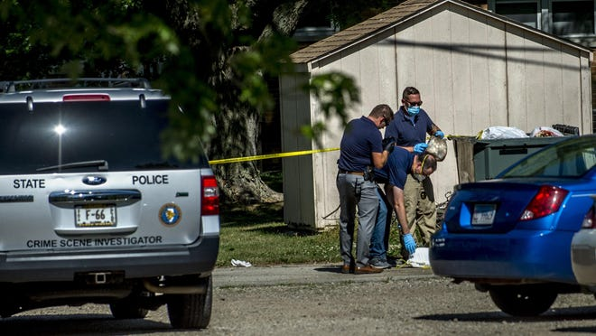 Investigators work at the scene of what Washington police officials say was a homicide at an apartment building in the 600 Block of East Holland Street in Washington on Monday, June 29, 2020.