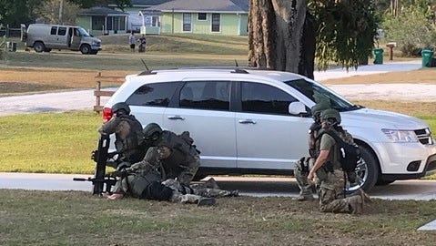 A SWAT team is on the scene in the area of Conley Place and Grovers Road in St. Lucie County on Monday, March 19, 2018.