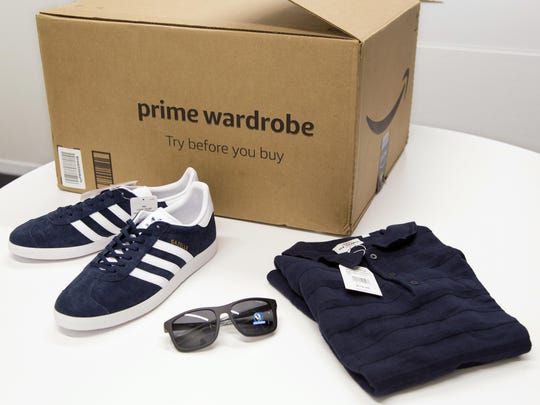 In this April 12, 2018 file photo, items ordered through Prime Wardrobe are displayed in New York. Amazon hopes to turn your home into a fitting room, after shipping you a box of fashions to try on before paying. It sounds a lot like Stitch Fix, Trunk Club or other services that send clothing in a box. But there are differences: There are no stylists with Prime Wardrobe, so you'll have to pick out your own shirts or skirts.
