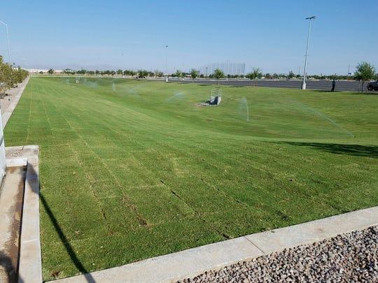 Grassy field near new parking lot on Bethany Home Road