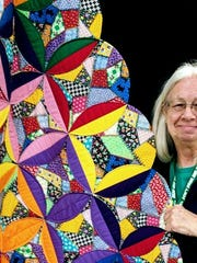 Deming Quilting B co-President Cathy Boutwell shows some of the handy work the Deming Quilting B's have done in the past. The Deming Arts Council will host a quilting show for the month of March featuring new work from the local group. An artists' reception will be held from 1 to 3 p.m. on Sunday, March 1, at the Deming Art Center, 100 S. Gold St.