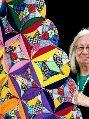 Deming Quilting B President Cathy Boutwell displays the quilt that will be raffled off during the Deming Quilting B's fourth annual Trunk Show from 9 a.m. to 4 p.m. on Thursday through Saturday, March 9-11, in the Transportation Room of the Deming-Luna-Mimbres Museum.