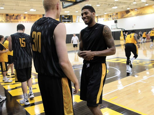 Iowa's Devyn Marble jokes with Aaron White during practice at Carver-Hawkeye Arena on Aug. 5, 2013.