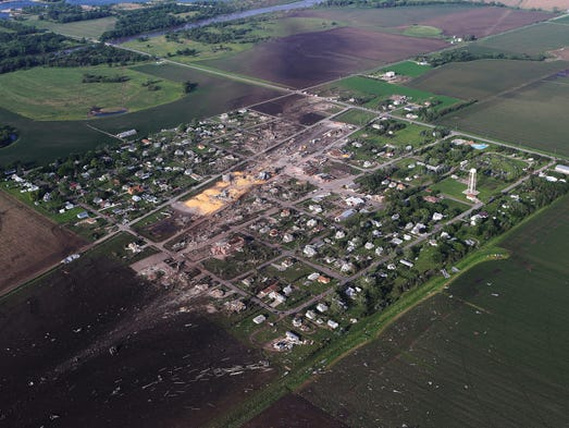 An aerial view of Pilger, Neb. On Monday, a storm packing rare dual tornadoes tore through the tiny farming town in northeastern Nebraska.