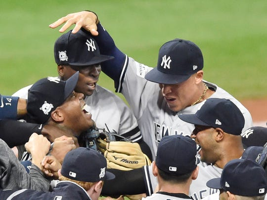 New York Yankees shortstop Didi Gregorius, left facing, and right fielder Aaron Judge (right facing) celebrate after winning game five of the 2017 ALDS playoff baseball series at Progressive Field on Oct., 11, 2017.