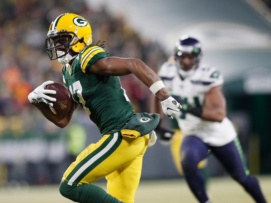 Jan 12, 2020; Green Bay, WI, USA; Green Bay Packers wide receiver Davante Adams (17) scores a touchdown against the Seattle Seahawks in the third quarter of a NFC Divisional Round playoff football game at Lambeau Field. Mandatory Credit: Jeff Hanisch-USA TODAY Sports
