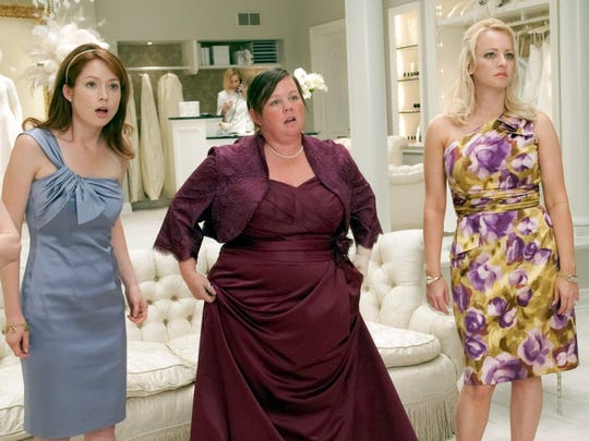 "Melissa McCarthy, center, between Ellie Kemper and Wendi McLendon-Covey, earned a best supporting actress nomination for her 2011 comedy ""Bridesmaids."""
