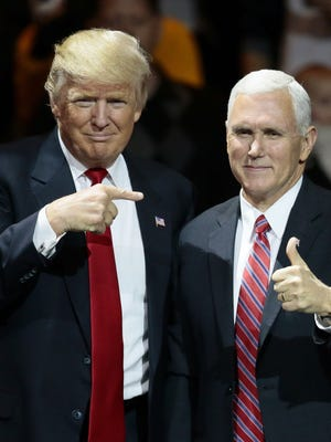 Donald Trump (left) and Mike Pence during their visit to Cincinnati in December,