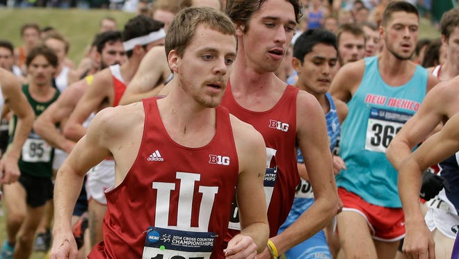 Indiana's Jason Crist, left, and Evan Esselink run in the men's NCAA Division I Cross-Country Championships, Saturday, Nov. 22, 2014, in Terre Haute, Ind.  (AP Photo/Darron Cummings)