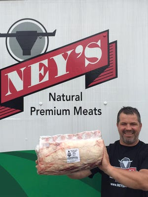 Doug Ney holds a trimmed bone-in ribloin, perfect for restaurant prime rib or cut steaks.