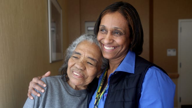 Carole Jones, right, a certified nursing assistant at the Wartburg Home in Mount Vernon, spends time with Belen Alvarado, a client in the home's adult day care center March 16, 2017.