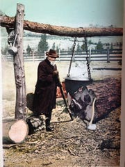 """A warmly dressed man, amply supplied with firewood, tends a kettle of maple syrup in Danville.The image is from a postcard posted March 27, 1907. Its caption reads: """"Making Maple Sugar in the Good Old Fashioned Way, Vermont.""""From the Annie Foster Stone Postcard Collection."""