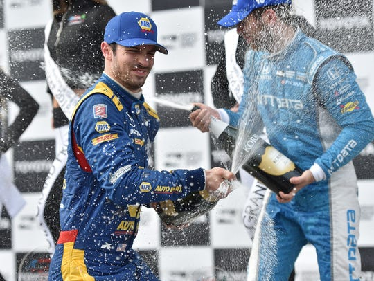 Alexander Rossi sprays the champagne on third-place
