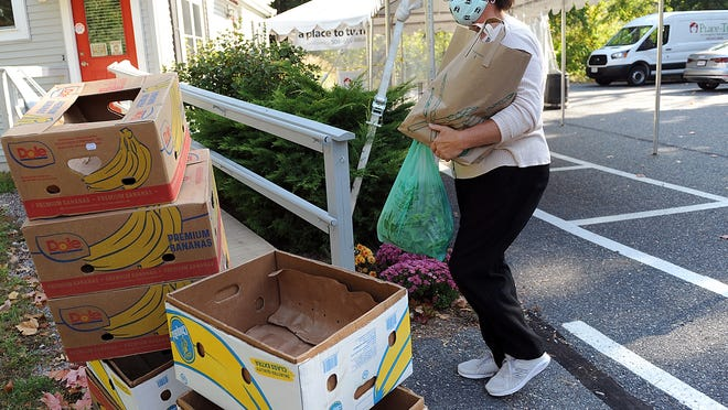 Karen McCullough, food resource and nutrition coordinator at A Place to Turn in Natick, brings in fresh produce from Stearns Farm in Framingham.