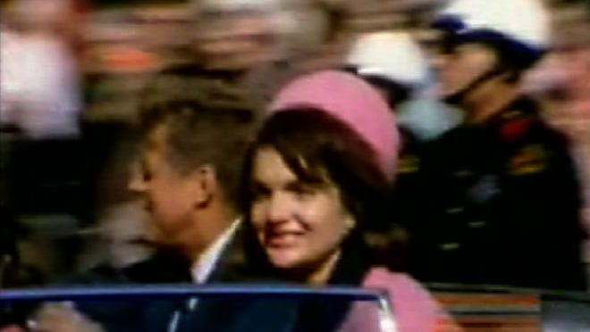 This image made from a home movie released Monday, Feb. 19, 2007, by the Sixth Floor Museum at Dealey Plaza shows former President John F. Kennedy, left, and his wife Jacqueline moments before his assassination in Dallas on Nov. 22, 1963. The recently discovered silent, 8 mm color film made by amateur photographer George Jefferies was unveiled on the museum's Web site.