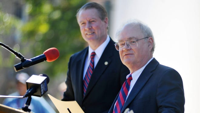 Alan Perry, right, president of the Board of Trustees of State Institutions of Higher Learning, and Glenn F. Boyce, Commissioner of Higher Education, speak after Jeffrey Vitter was announced as the preferred candidate for the chancellorship of the University of Mississippi, outside the Lyceum at the University of Mississippi, Oct. 19 in Oxford.
